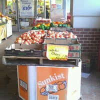 Photo taken at Magruder's Grocery Store by Jose R. on 4/3/2012
