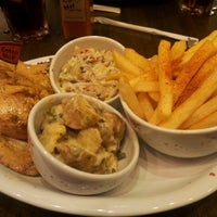 Photo taken at Nando's by NorDiana N. on 3/31/2012