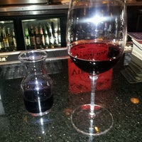 Photo taken at Virgilio's Pizzeria & Wine Bar by Molly H. on 5/1/2012