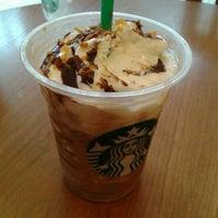 Photo taken at Starbucks by Ivonne E. on 7/21/2012