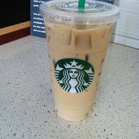 Photo taken at Starbucks by Michelle L. on 5/13/2012