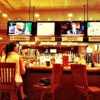 Photo taken at Smokey Bones Bar & Fire Grill by Jan F. on 2/11/2012