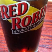 Photo taken at Red Robin Gourmet Burgers by Brandon C. on 7/4/2012
