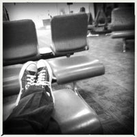 Photo taken at Gate B33 by Ryan S. on 2/6/2012