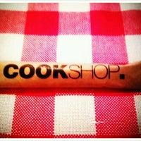 Photo taken at CookShop by Berfu O. on 3/3/2012