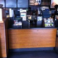 Photo taken at Starbucks by Ricardo G. on 7/7/2012