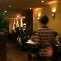Photo taken at Wild Ginger Pan-Asian Vegan Cafe by Leigh R. on 5/11/2012