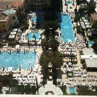 Photo taken at The Pool At Bellagio by Felipe K. on 3/31/2012
