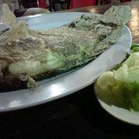 Photo taken at อิ่มปลาเผา ประชานิเวศน์ by Bobo on 7/21/2012