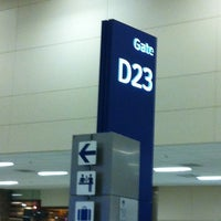 Photo taken at Gate D23 by Adrian P. on 9/2/2012