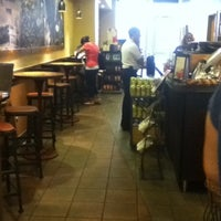 Photo taken at Starbucks by Kelly S. on 8/4/2012