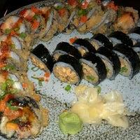 Photo taken at Hook's Sushi Bar & Thai Food by TJ T. on 3/12/2012