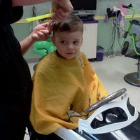 Photo taken at Wiggle Worms Children's Hair Studio by Chrissy D. on 4/10/2012