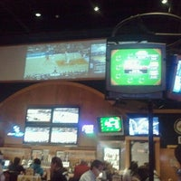 Photo taken at Buffalo Wild Wings Grill & Bar by Norman P. on 2/21/2012