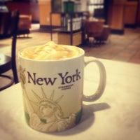 Photo taken at Starbucks by Dina R. on 4/15/2012