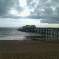 Photo taken at Hastings Pier by Gustav G. on 3/18/2012
