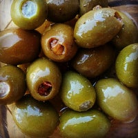 Photo taken at Olives Gourmet Grocer by Shelby on 8/7/2012