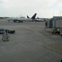 Photo taken at Gate E2 by Jorge S. on 7/31/2012