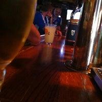Photo taken at Mulligan's Pub by Jordan M. on 7/22/2012