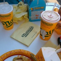Photo taken at Nathan's Famous by Mina V. on 8/18/2012