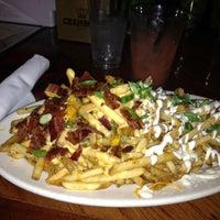 Photo taken at Jonesy's Eat Bar by Lisa F. on 5/17/2012