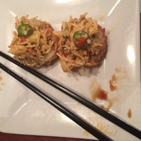 Photo taken at Sushi Axiom by Suzanne S. on 8/16/2012