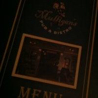 Photo taken at Mulligan's Irish Pub by Winnie S. on 6/7/2012
