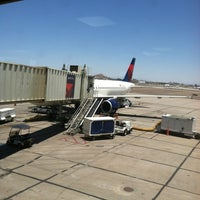 Photo taken at Gate 23 by Rob G. on 6/15/2012
