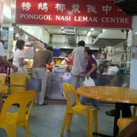 Photo taken at Ponggol Nasi Lemak Centre by HSINMIN L. on 7/18/2012