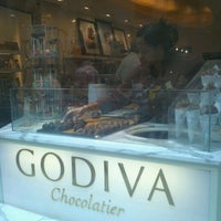 Photo taken at Godiva Chocolatier by Mirella M. on 6/27/2012
