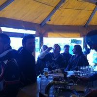 Photo taken at Yellow Tent Open Air Après Ski Bar by Martin C. on 3/23/2012