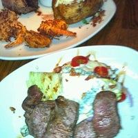 Photo taken at Outback Steakhouse by Holly M. on 5/17/2012