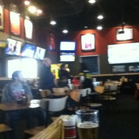 Photo taken at Buffalo Wild Wings by Gina G. on 2/11/2012