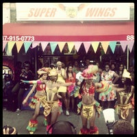 Photo taken at SUPER WINGS NY by Juan P. on 4/18/2012