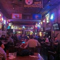 Photo taken at Bikinis Sports Bar & Grill by iGoByDoc on 3/12/2012