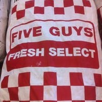 Photo taken at Five Guys by Christy N. on 5/2/2012