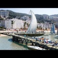 Photo taken at Playa de los Muertos by CARLOS G. on 8/4/2012