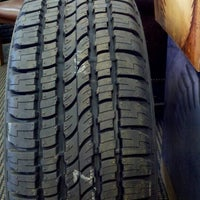Photo taken at Riley Park Tire by Katie W. on 8/9/2012