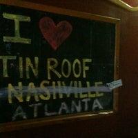 Photo taken at Tin Roof Cantina by Erik L. on 8/18/2012