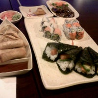 Photo taken at Yummy Sushi by Laura B. on 3/17/2012