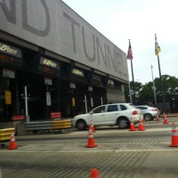 Photo taken at Holland Tunnel Toll Plaza by nancita j. on 5/27/2012