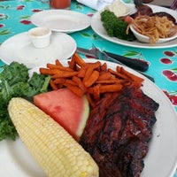 Photo taken at Lucille's Smokehouse Bar-B-Que by Jae R. on 9/9/2012