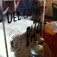 Photo taken at Del Carmen's Pizza East by Rebecca N. on 4/17/2012