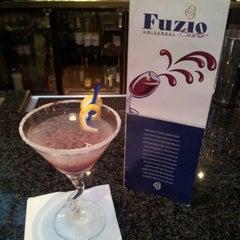 Photo taken at Fuzio Universal Bistro by Tony C. on 7/28/2012