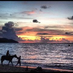 Photo taken at Batu Ferringhi Beach by Kim M. on 5/6/2012