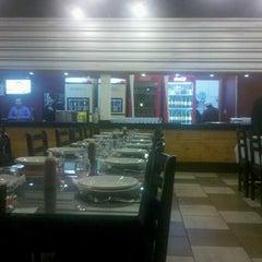 Photo taken at Cia do Sabor Pizzaria by Deivisom O. on 6/19/2012