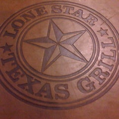 Photo taken at Lone Star Texas Grill by Calvin r. on 8/15/2012