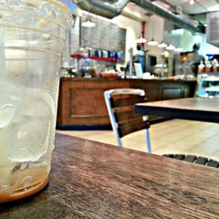 Photo taken at Delectica Cafe by Joshua N. on 9/13/2012