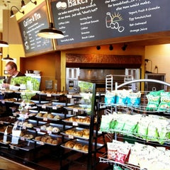 Photo taken at Specialty's Café & Bakery by Kate K. on 5/10/2012