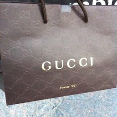 Photo taken at Gucci by Bander A. on 9/12/2012